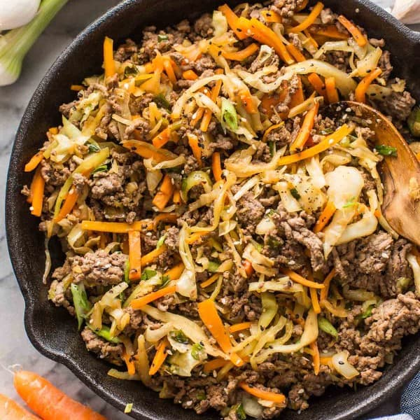 Beef & Cabbage Stir Fry in a cast iron skillet