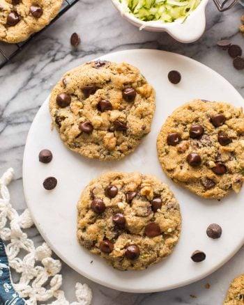 three almond flour zucchini cookies on a plate