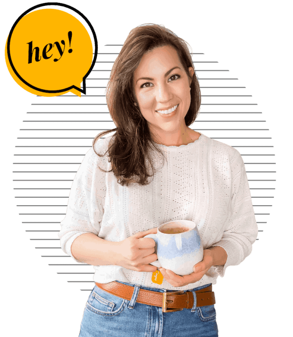 Sarah Nevins from A Saucy Kitchen holding a coffee mug