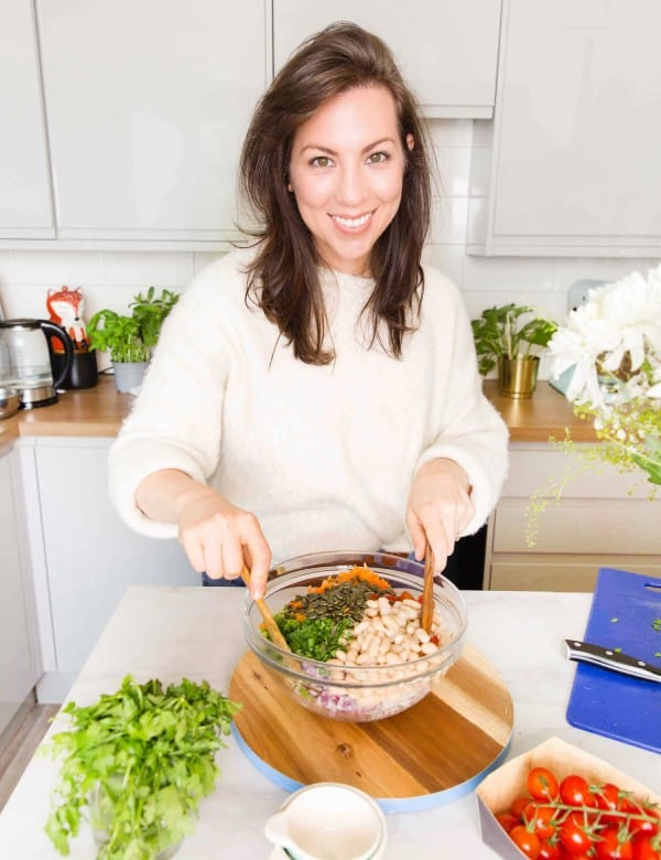 Sarah Nevins from A Saucy Kitchen making a salad