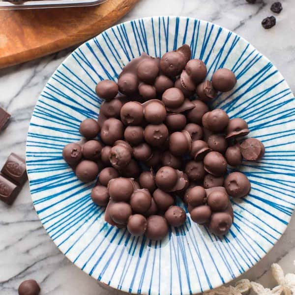 Chocolate-Covered-Blueberries in a blue and white striped bowl