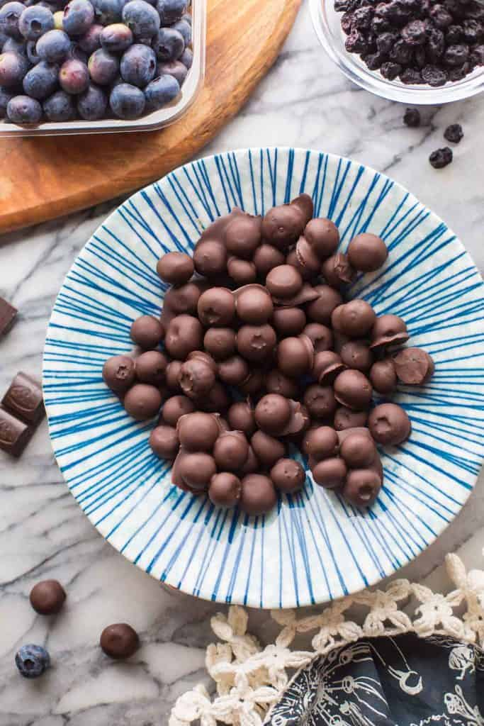 a bowl of Chocolate Covered Blueberries