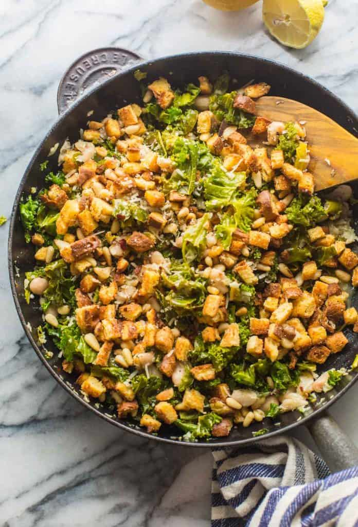 cannellini and kale stir fry in a cast iron skillet
