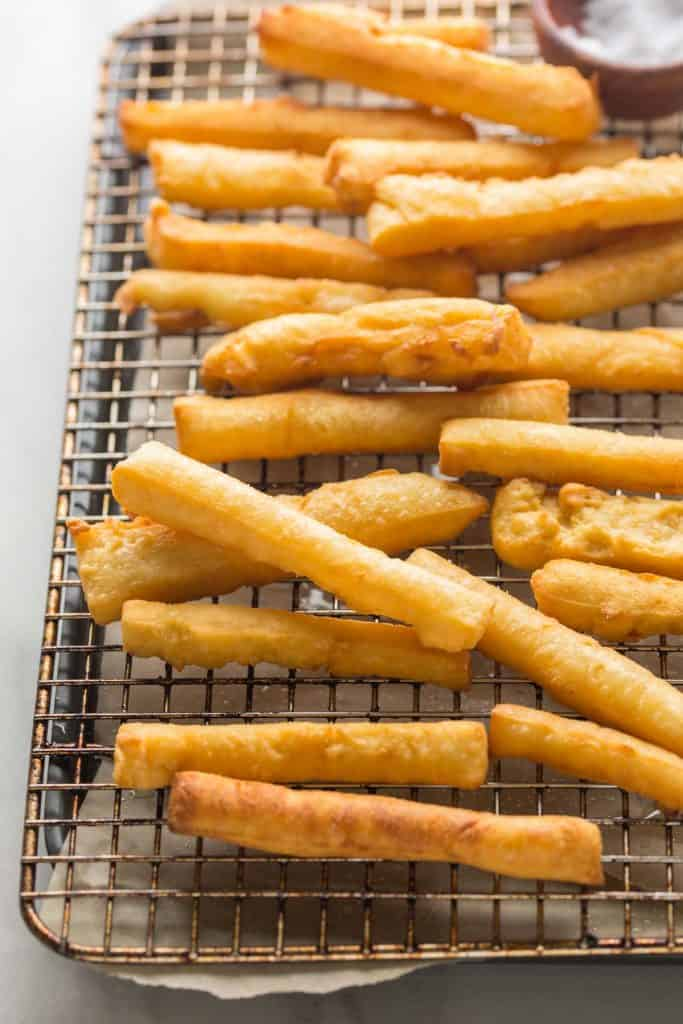 chickpea fries spread out on a wire cooling rack