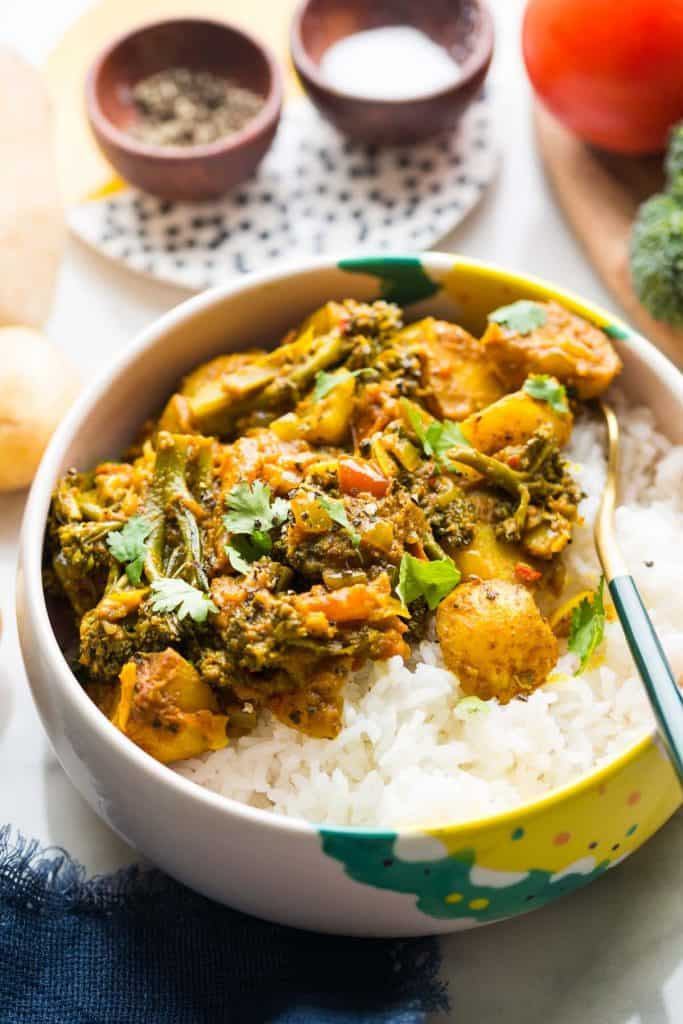 broccoli and potato curry in a bowl with rice