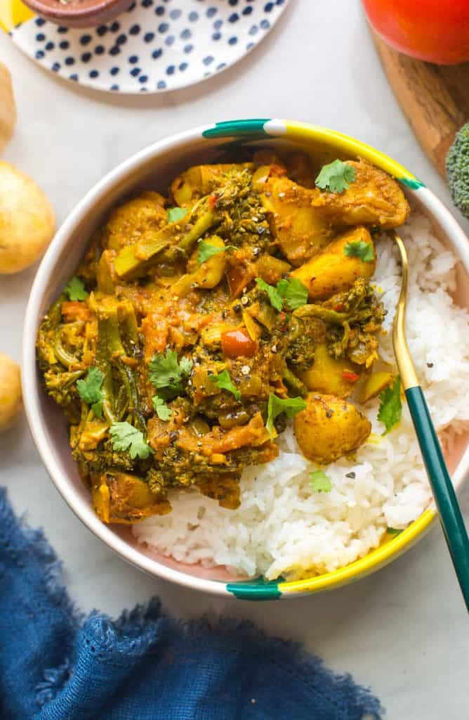 Stir Fried Broccoli Potato Curry in a bowl over rice