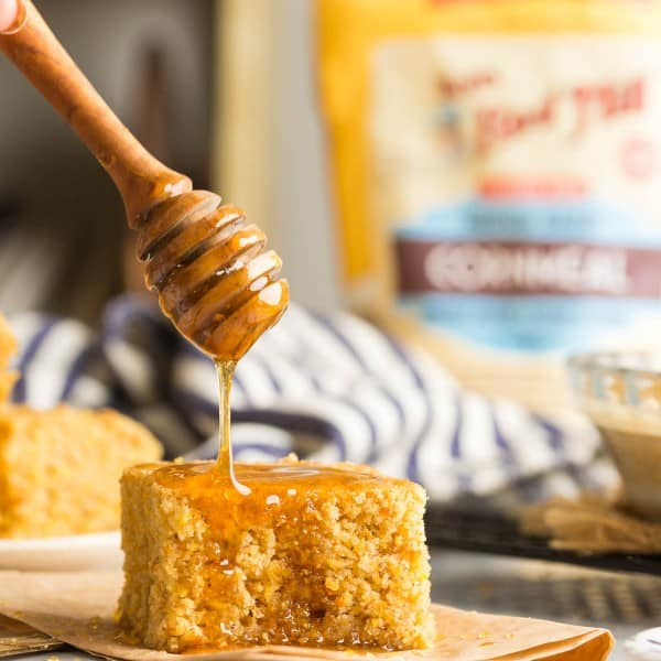 gluten free cornbread with honey drizzling over the top