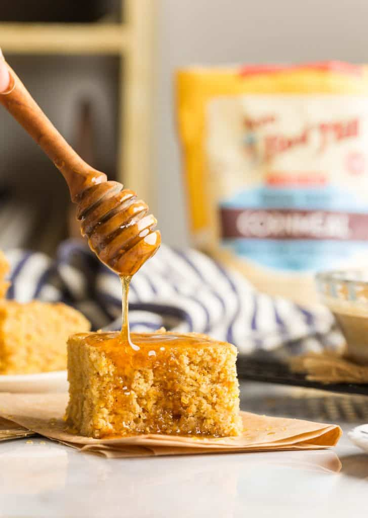 a slice of Gluten Free Cornbread with honey drizzling over the top