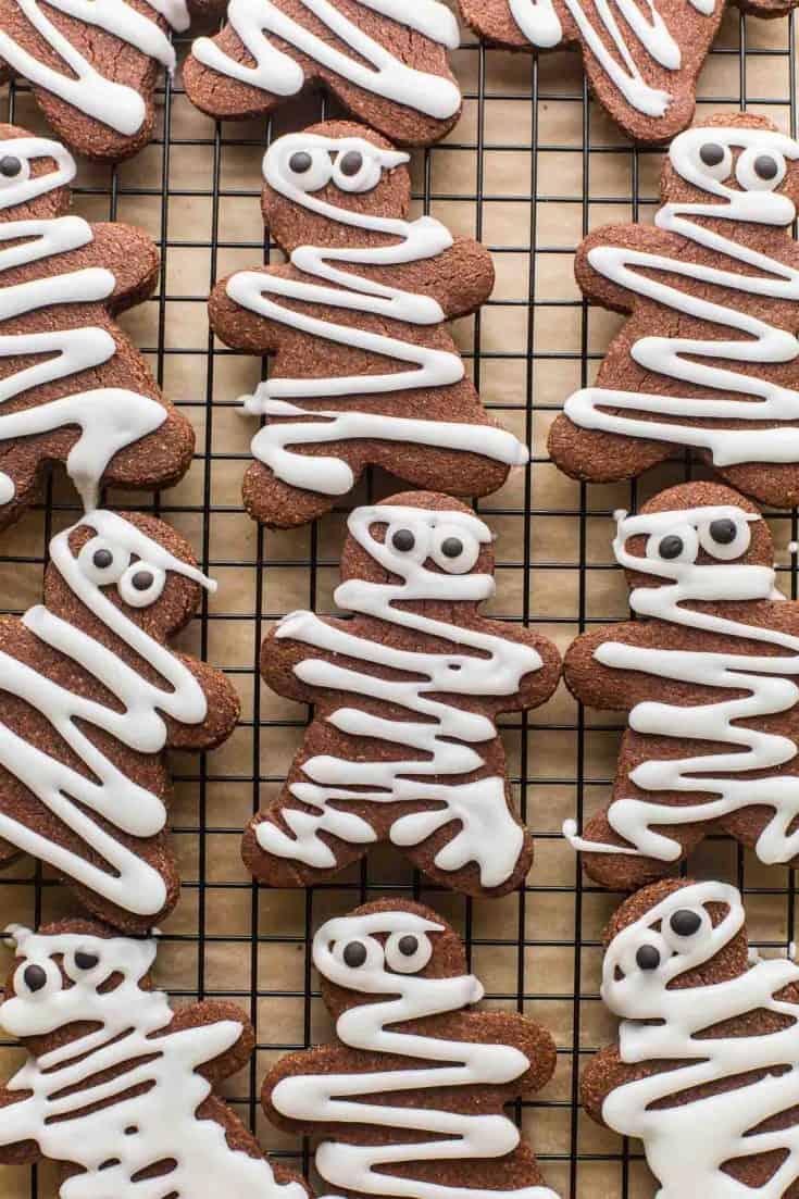 chocolate sugar cookies decorated like mummy gingerbread men
