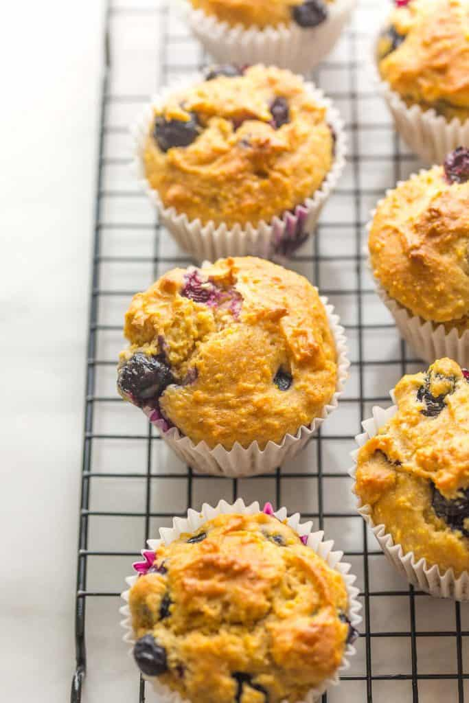 Gluten Free Blueberry Cornbread Muffins cooling on a wire rack