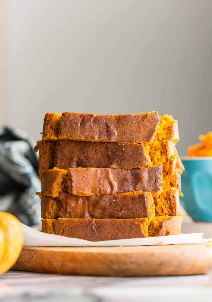 five slices of gluten free pumpkin bread stacked on top of each other