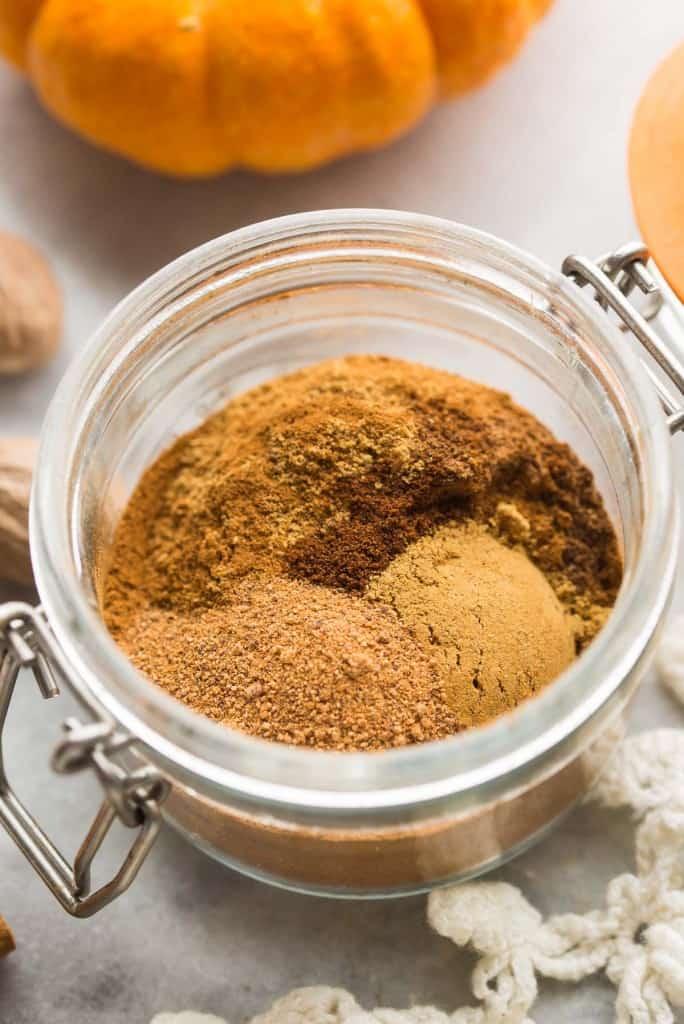 unmixed Pumpkin Pie Spice recipe in a small jar