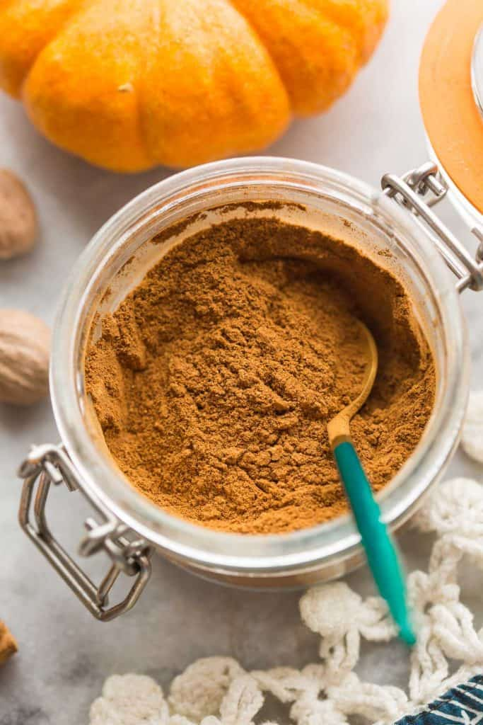 homemade pumpkin pie spice recipe in a jar with a spoon