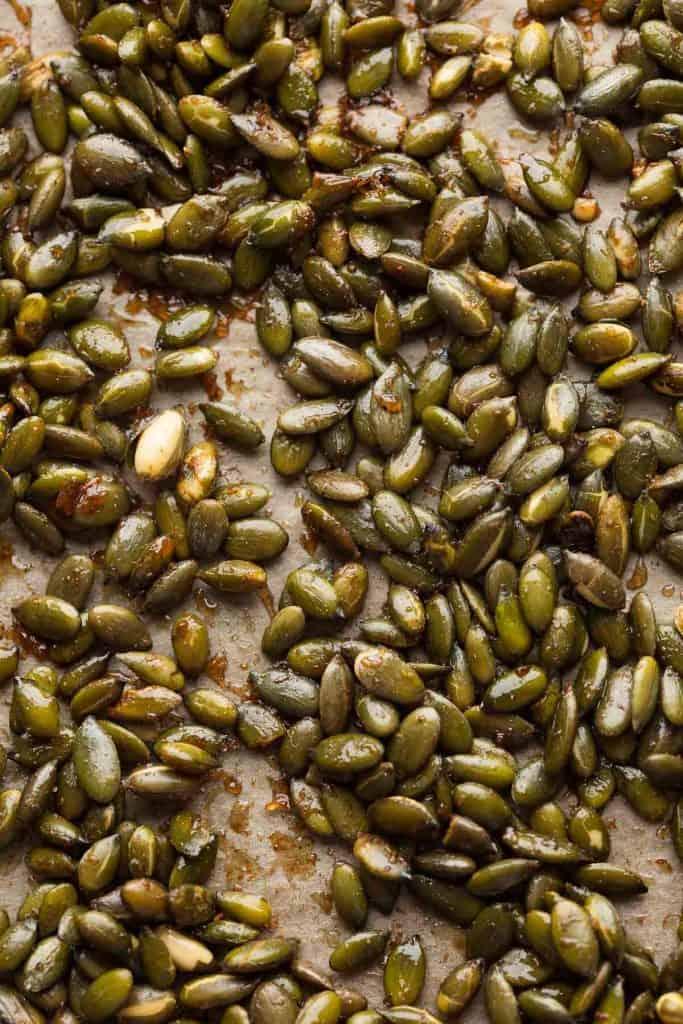 cinnamon sugar Roasted Pepitas Recipe up close on a baking sheet