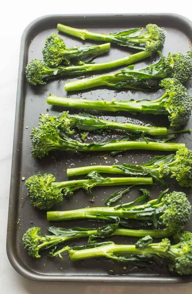 raw tenderstem broccoli on a baking sheet